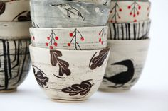 BlackbirdPottery - I like that it's clearly a set, but they're each different