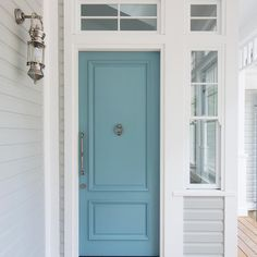 Such a pretty door colour and wall sconce choice by our client on our latest new home construction. Gray Front Door Colors, Grey Front Doors, Door Paint Colors, Double Front Doors, Painted Front Doors, Glass Front Door, Front Entry, Front Porch, Glass Doors