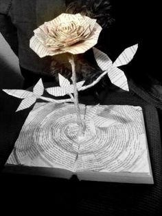 """The Tower Rose--book sculpture built from """"The Dark Tower"""" by Stephen King. $700.00, via Etsy."""