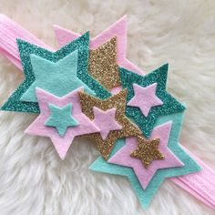 So perfect for twinkle twinkle little star parties!! Handmade felt star headband. Each headband will be slightly different! Made with high quality wool blend felt. Finished with soft foldover elastic in the back. Choose pink, white, and gold or pink, mint, and gold. Can be customized in any colors via DM! Please specify age in comments for sizing. NB-adult