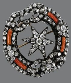 Diamond and Enamel Brooch, Russian, circa 1880. Designed as a six-pointed star within a circle enhanced with bow-knots and florets, decorated with segments of translucent orange enamel over a guilloché ground and set with numerous old-mine diamonds, mounted in gold and silver.