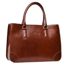 Chic and sophisticated, this raisin brown tote is constructed from Italian leather. With zippered pockets, a glasses slot, and more inside this handbag is finished with shiny chrome hardware.