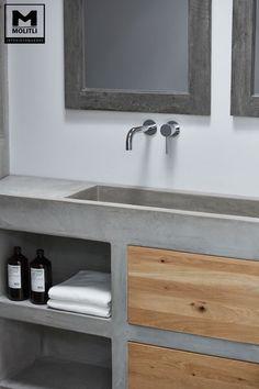 Betonstuc badkamer met verzonken bad