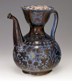 Ewer. Irises and poppy heads. Made of lustre, cobalt glazed and moulded ceramic, pottery.