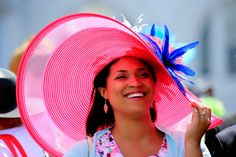 Race fans wearing a festive hat attends the 140th running of the Kentucky Derby at Churchill Downs.