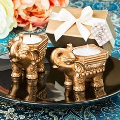These gold elephant candles will light up your jewel toned wedding with the opulent gold and clear rhinestones. The east Asian design candle is a perfect way of offering good luck favors to your wedding guests and makes a beautiful statement piece to your table.  #GoldElephantCandles #GoldElephantWeddingFavors #WeddingCandeFavors