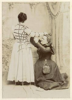 Victorian Seamstress, 1890s. [Think how hard this is. On your feet and even on your knees most of your working day.]