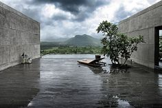 Mumbai firm Spasm Design took a cue from the basalt outcroppings that dot India's Maharashtrian countryside in order to create the minimalist Khopoli House. The villa's basalt slabs, formed from ancient volcanic activity, emerge organically from the cliff and dramatically frame the distant mountains.