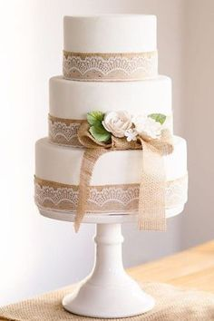 rusticwhite wedding cake with burlap lace details / http://www.deerpearlflowers.com/rustic-country-burlap-wedding-cakes/ #laceweddingcakes #BurlapWeddings