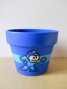 Mega Man 8Bit Painted Flower Pot sold by Ginger Pots. Shop more products from Ginger Pots on Storenvy, the home of independent small businesses all over the world.