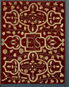 The Embroidery Exhibition, Hardwick. View of an embroidered red velvet panel bearing the `ES' monogram of Elizabeth, Countess of Shrewsbury (Bess of Hardwick), c.1527-1608.