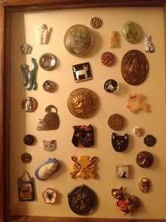 More Cat Buttons , framed, from my collection. Collector Note: From the collection of Lynn Williams