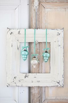 Vintage ornaments hung on vintage frame | Dreamy Whites Blog