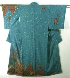 This is an exotic Houmongi Kimono by Hiroko Koshino, one of the famous designers in Japan. It has a fashionable design of geometric design, flower and bird, which is dyed.