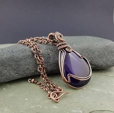 A striking purple agate cabochon I have wire wrapped and woven using solid copper wire to make this statement pendant. I have given it a patina to age the copper and highlight the weave, then hand polished it to this lovely antique copper finish. The purple agate pendant measures approx.