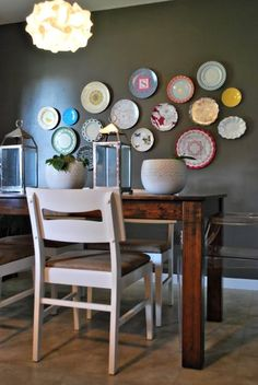 plates on kitchen wall. love that design and that she even through in melamine plates (kid safe)