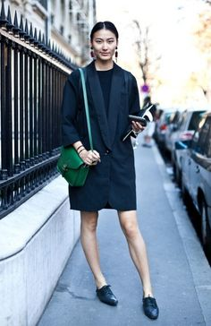 Add a pop of color to an all-black outfit with a colorful cross-body like this bright green one