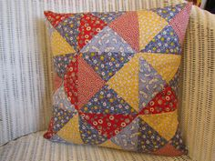 Primary triangles patchwork cushion cover