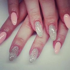 cute acrylic nails with glitter. Oval shape.