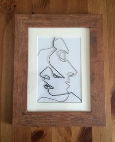 tangled faces a wire art picture of intertwining male by designIBY