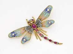 An Enamel, Diamond and Ruby Dragonfly Brooch   The dragonfly decorated with diamonds and cabochon rubies, with plique-a-jour enamelled wings, mounted in 18k gold