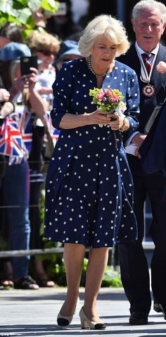 A delighted Camilla was presented with several bouquets of flowers from locals as she cond...