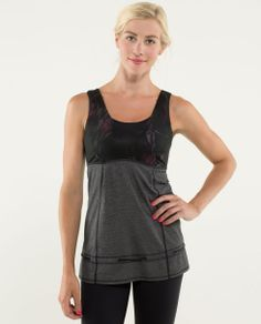 why we made this Enjoy it while it's hot! We designed this medium-coverage tank with lightweight, moisture-wicking fabrics and a loose fit to help keep us cool when we're working out in the summer heat. Made to fit over our favourite bra, this top lets us choose the perfect support.58.00