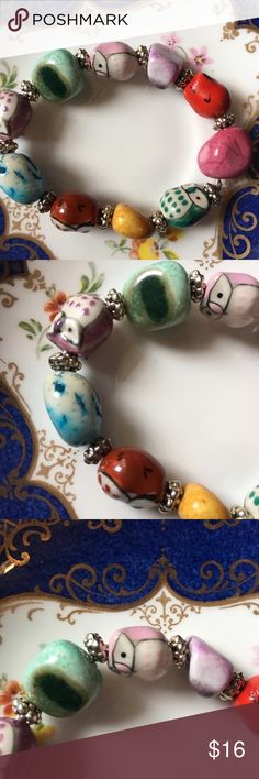 Multi colored ceramic and stone owl bracelet Cute owl and stone bead bracelet. 7 1/2 inches, stretch bracelet. Silver beads are lead and nickel free. Handmade Jewelry Bracelets