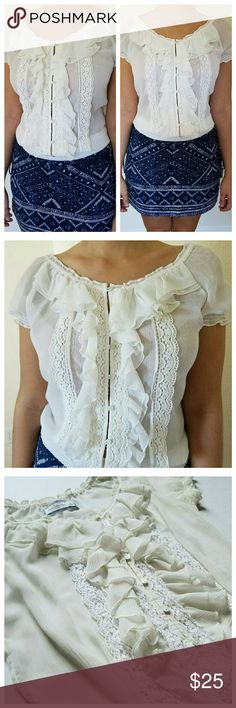 NWOT Off White Sheer Ruffle Blouse New without tags off white sheer blouse. Ruffle and button detailing on the front with an elastic waist and shoulder band. Can be worn off the shoulder. No rips. No stains. True to size. Abercrombie & Fitch Tops Blouses