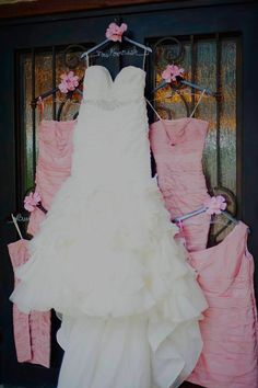 Personalized hangers for a beautiful wedding dress photo from twistedhangers.com