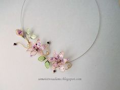 Wire pink lily necklace with nail polish by semeistvoadams.blogspot.com