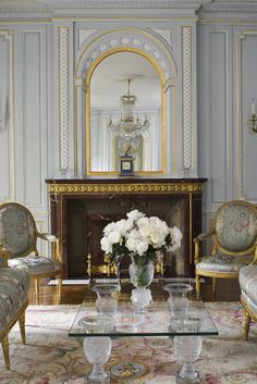 In the living room of a New York apartment, design legend Robert Couturier used Louis XVI–style paneling from Féau.