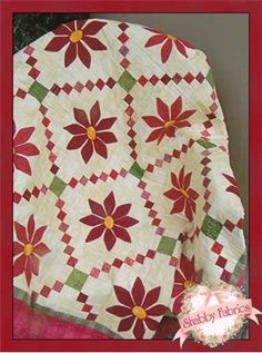 "Christmas Poinsettia: Piecing and applique come together for a beautiful holiday quilt!  Pattern includes all instructions to complete the 48"" x 56"" quilt."
