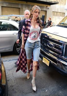 Gigi Hadid worked this flannel and jean short look while out in New York City.