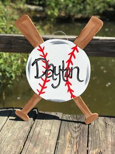 This is a great wall or door hanger for baseball season. It can be personalized with a saying of your choice or with a name. A clear coat is applied to protect from weathering and minimize fading. Just keep in mind this will be painted just for you , so it may vary slightly. It