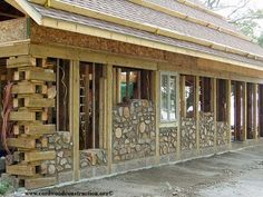 Cordwood builders most often use a post and beam framework for cordwood construction. This method helps the owner/builder get the roof on, work on one section at at time, store materials safely and work out of the elements. Some folks like the stackwall corner approach and this picture shows the marriage of both concepts. This stackwall corner is basically a pre-made post that functions like a regular post, yet provides those who desire it, the stackwall corner look.