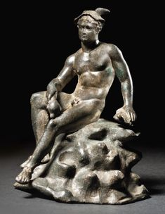 Roman bronze statue of seated Mercury, circa 1st-2nd Century A.D., 4 inches high