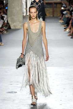 Spring fringe took a turn on the skirt of a woven Proenza Schouler dress, all over at Giambattista Valli and Marco de Vincenzo and on a leather pencil at Sonia Rykiel. While iterations varied, the fluid fabrication consistantly offered a dose of bohemia, while highlighting the female form.  Pictured: Proenza Schouler