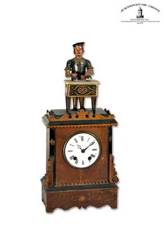 A collection of 1 varnished plate clock and 2 figural automa
