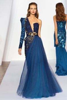 Love the one shoulder blue and gold