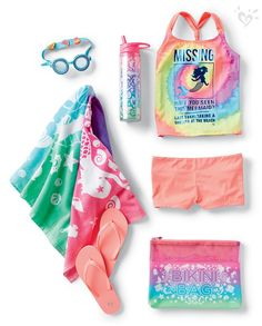 Be a surfside standout in a bright tankini, emoji goggles and ombre mermaid towel.