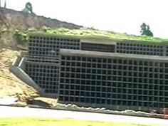 Mass Graves 4 months later Concrete vaults caskets LA   There are more video's , with these already barried!!!