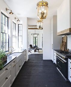 The perfect mixture of rustic and glam ✌️✨ some people dream about sugarplums, I dream about black and white kitchens  Also, I will be doing a post soon on the new no-upper cabinet trend. I am in love!! Happy Friday ya'll!!  Design by Jen Langston Interiors ... ... #fridayfavorites #fridayvibes #favoritethings #kitchen #kitchendesign #kitchenideas #homeinspo #kitchendecor #rusticdecor #blackandwhite #homefortheholidays #inspire_me_home_decor #house #home #interiordesign #interiordesigner