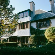 Charles Voysey's White Cottage (1903 Arts & Crafts) in Wandsworth Common, London.