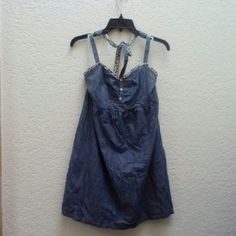 Old Navy Denim Halter Dress Old Navy, size small, in excellent condition! This denim sundress features a halter top, elastic at the back, floral neckline, and pockets! Please ask any and all questions before purchasing. No trades. Make a reasonable offer. Thanks! Old Navy Dresses Mini