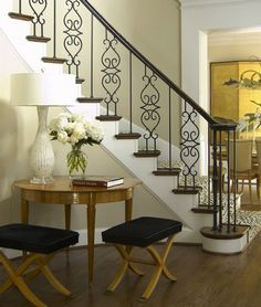 Zebra stair runner, double X benches, gorgeous iron work on stairs.