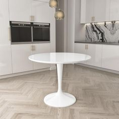 White round dining table with pedestal leg. #rounddiningtable #diningtable #roundtable #roundtables #diningtables #kitchentable #diningroomdecor #whitekitchen