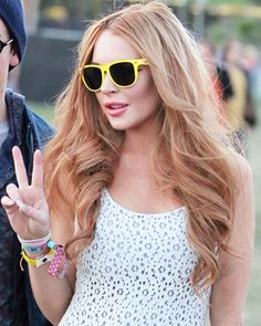 Lindsay Lohan's yellow-frames sunglasses are a match to the summer days' rays of sunshine