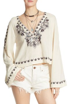 Long bell sleeves, a plunging neckline and a cute cropped hem make for a festive-ready tunic from Free People.