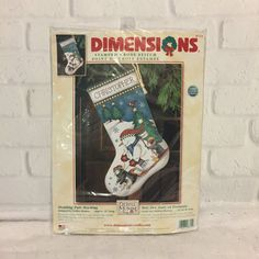 Dimensions STAMPED Cross Stitch Stocking Kit # 8715  Sledding Pals designed by Debbie Mumm  Really cute stocking of a snowman sledding down a hill  Kit is complete and never opened